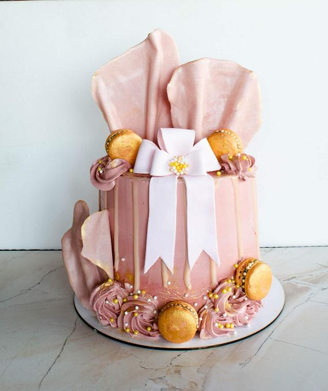 Cake with ribbon and chocolate waves
