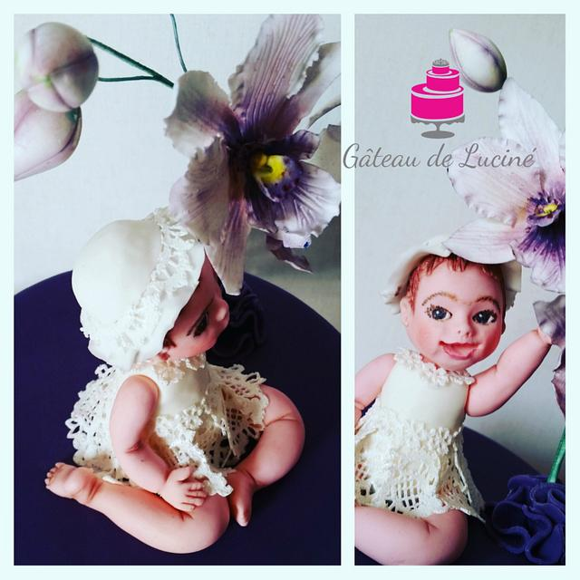Cattleya orchid cake with the figure of a little girl
