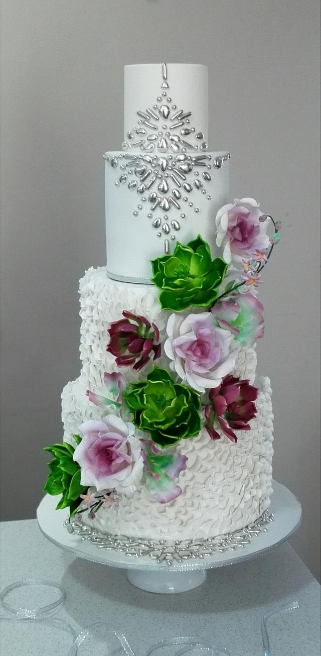 Wedding cake with succulents and roses