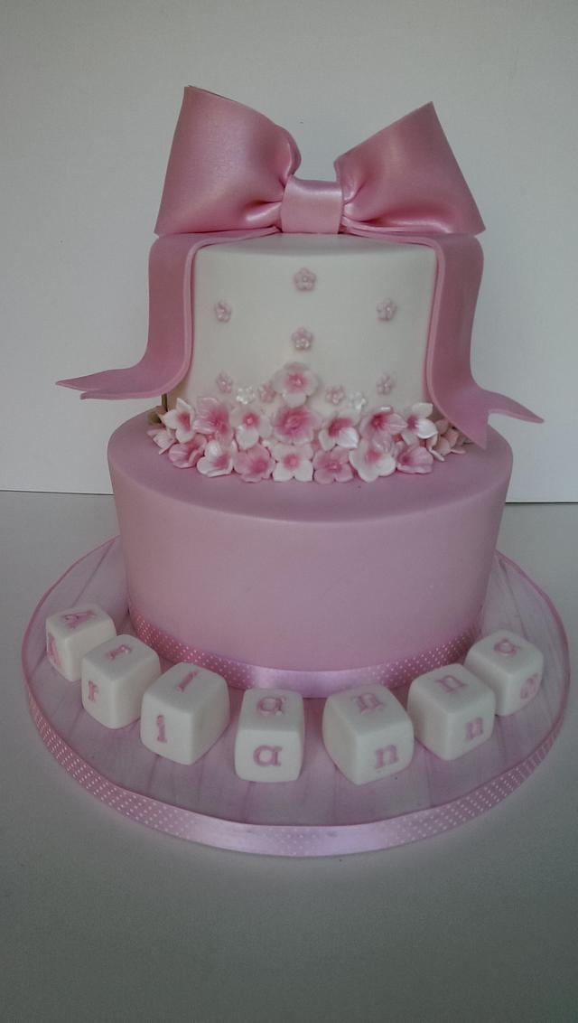 Flowers and bow Christening cake.