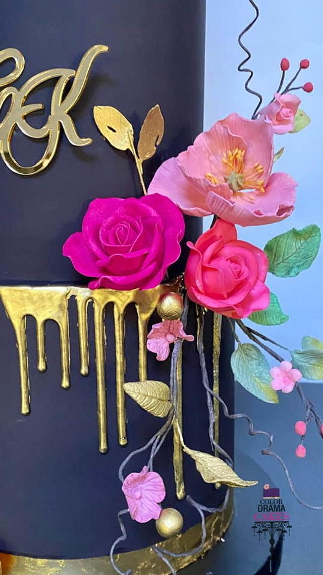 Black wedding cake with sugar flowers
