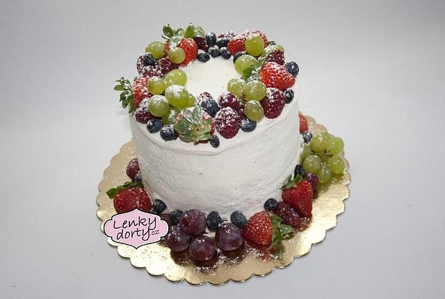 Fruit cake with whipped cream
