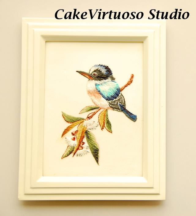 Bird embroidered on a cookie