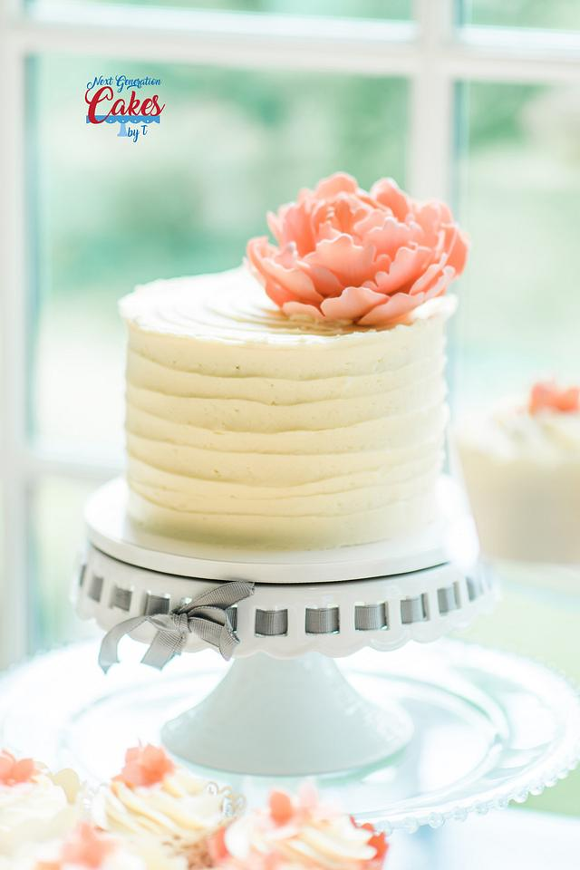 Ivory and peach wedding cake