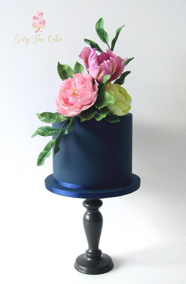 Navy blue one tier cake with sugar flowers