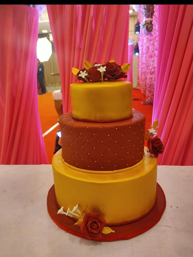 Red n gold wedding cake