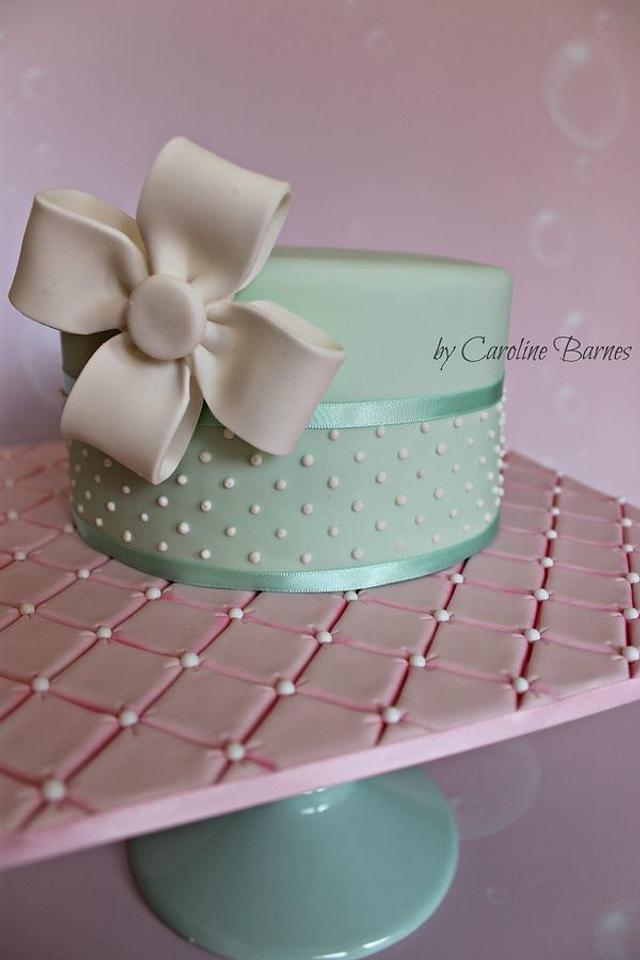 Polka dot cake with fondant bow and quilted cake board