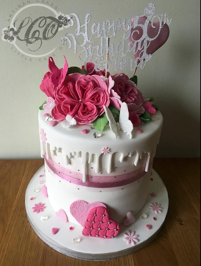 50th girlie pink drip cake