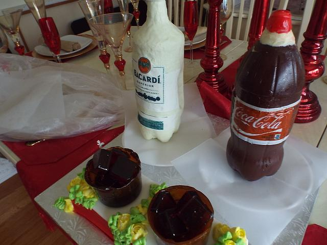 Rum and Coke bottles cake with sugar glass and ice cubes