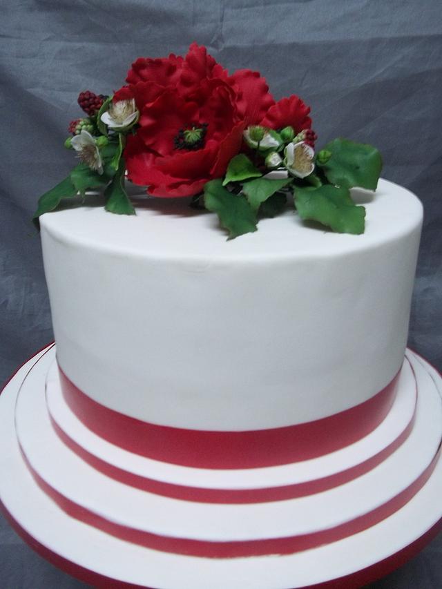 Poppy and blackberry wedding cake