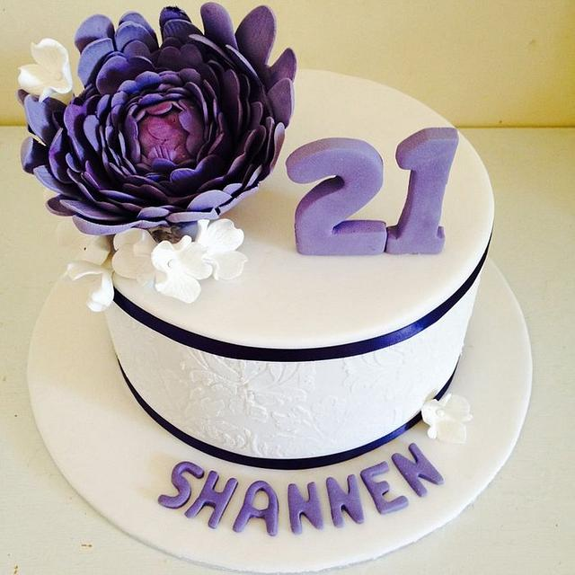 Stencilled 21 st cake with sugar flowers