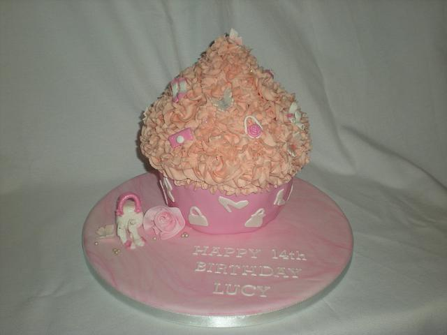 shoe and handbag themed giant cupcake