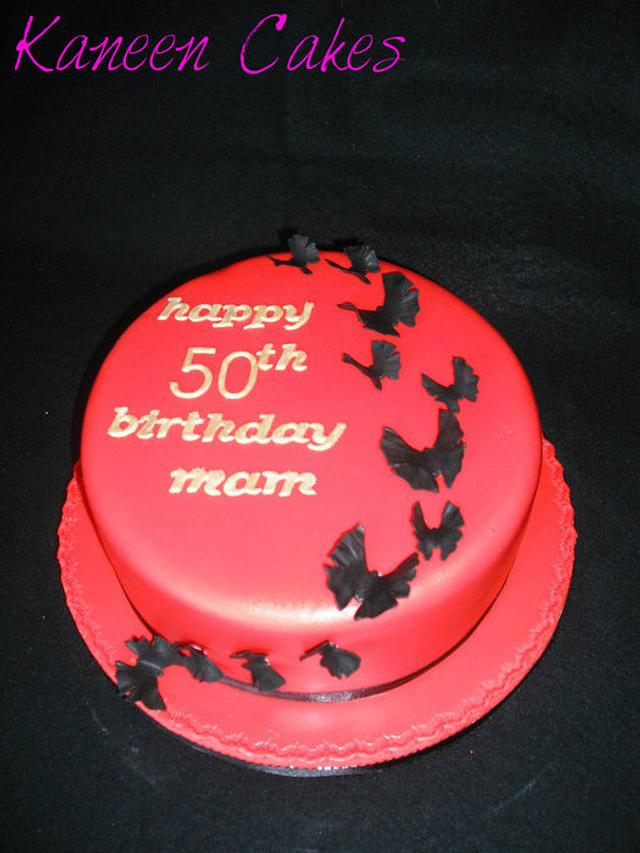 Butterfly scaling 50th birthday cake