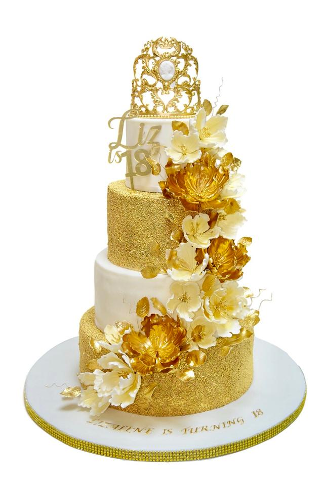 White and gold cake with peonies