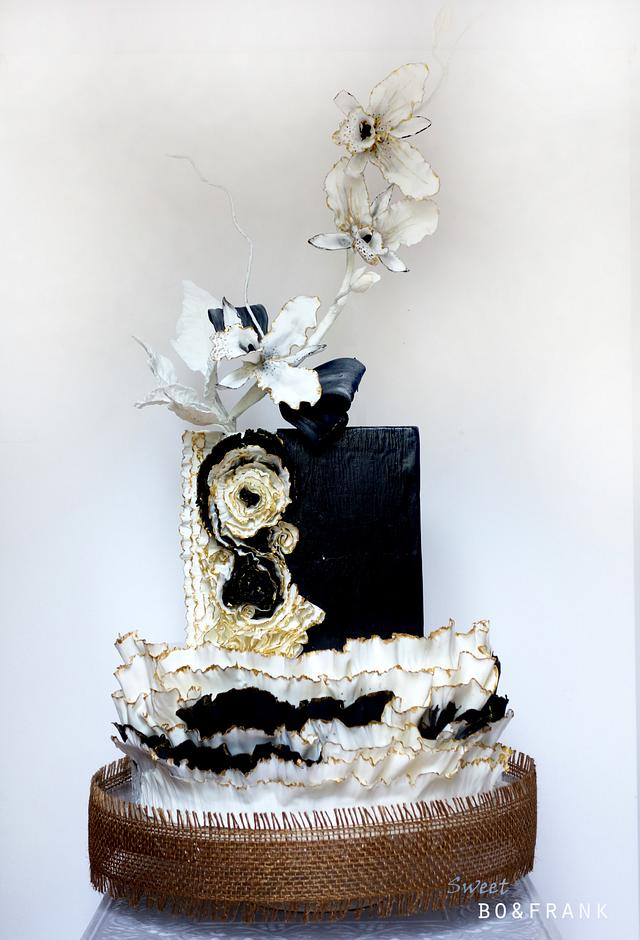 ORCHID CAKE - BLACK ,  WHITE ,GOLD AND FRILLS