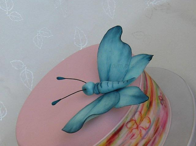 Painted cake with a butterfly