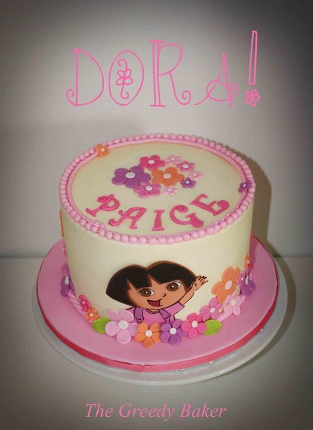 Dora buttercream cake with fondant accents
