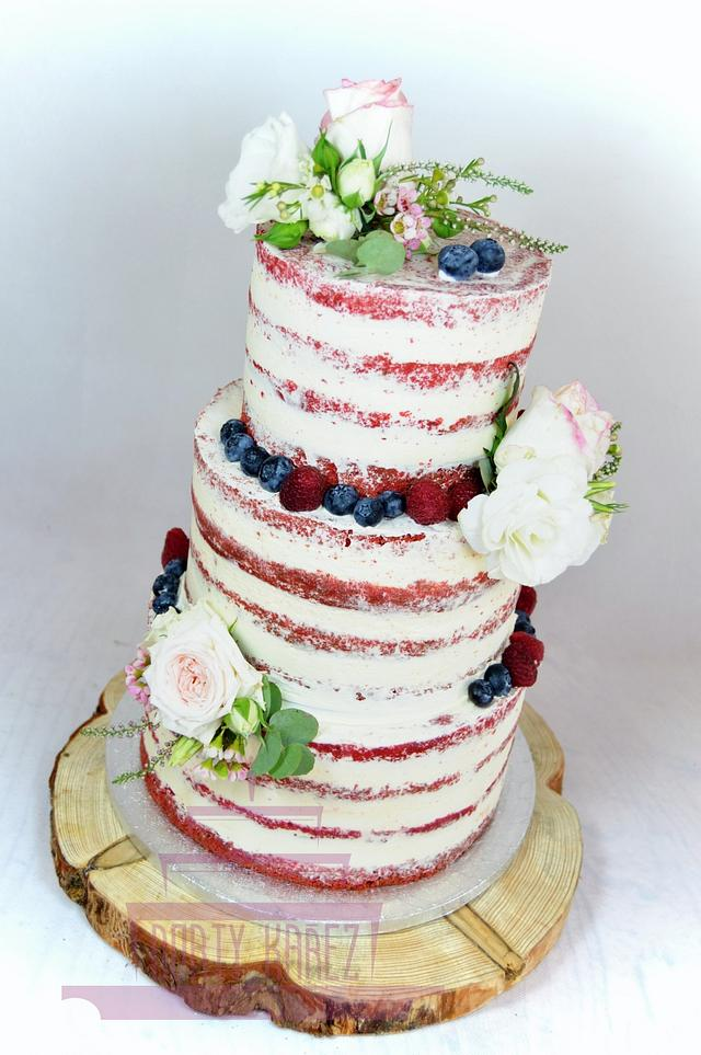 Semi naked wedding cake with furit and flowers