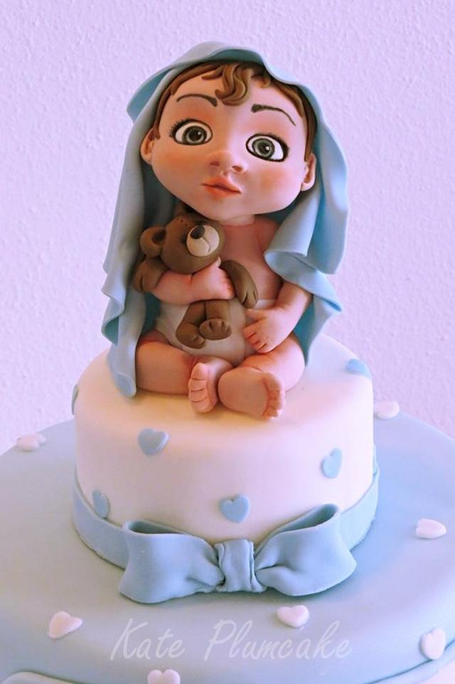 Christening cake with baby and teddy bear