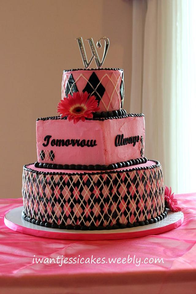 Pink & Black wedding cake with a rainbow inside