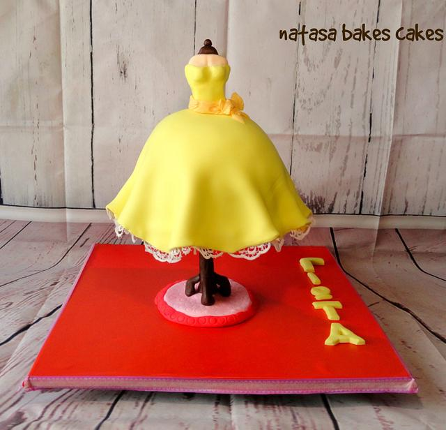 vintage dress gravity defying cake