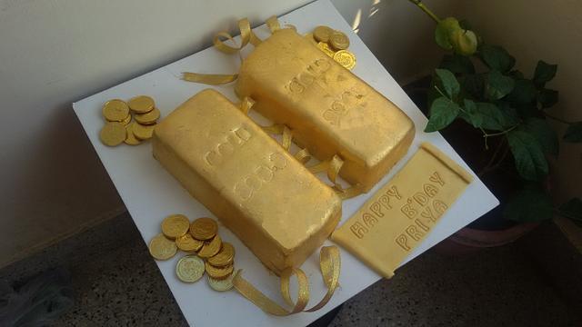 An edible gold bar cake