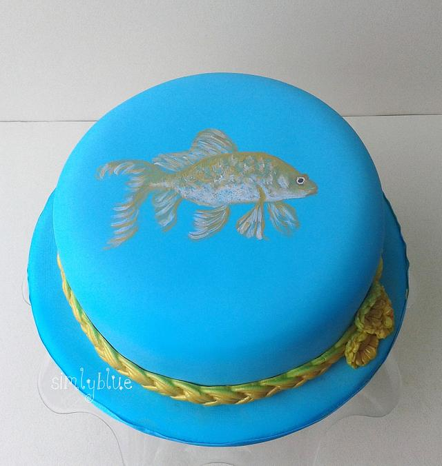 Cake hat with drawing fish