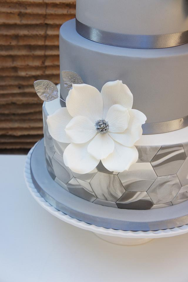 Wedding cake with marble fondant and magnolias