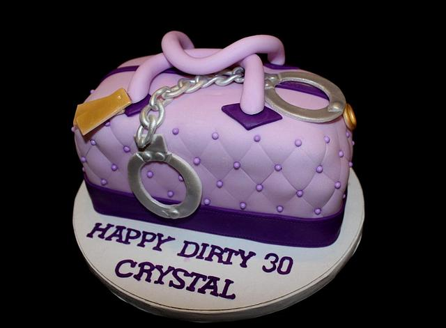 Purse cake with handcuffs