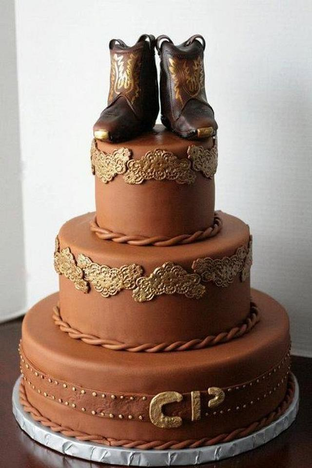 Cowboy wedding cake with edible boots on top.