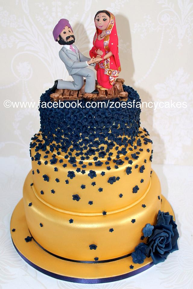 The finished gold and navy Indian wedding cake