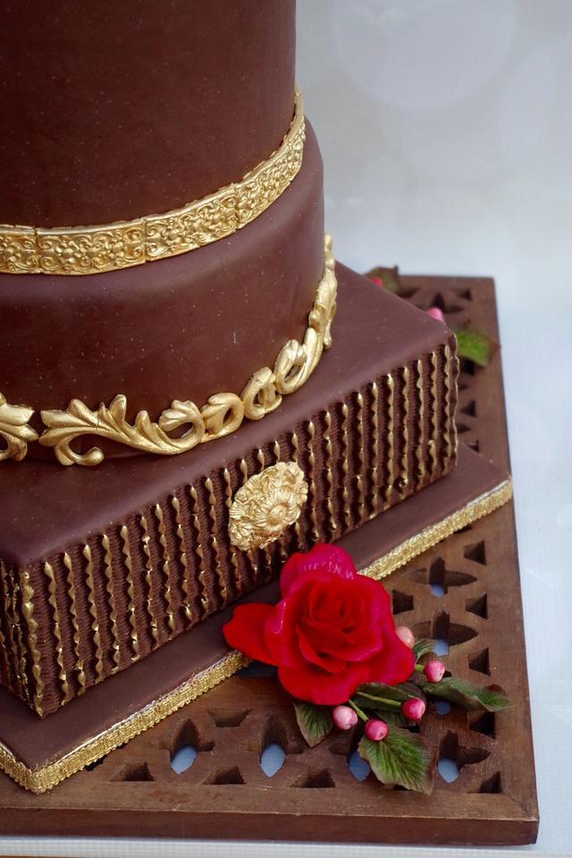 Chocolate and gold wedding cake