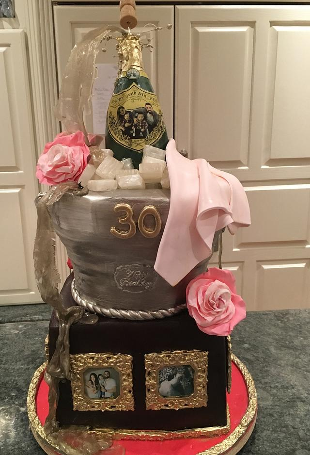 Champagne bottle bucket cake with picture frame family tribute