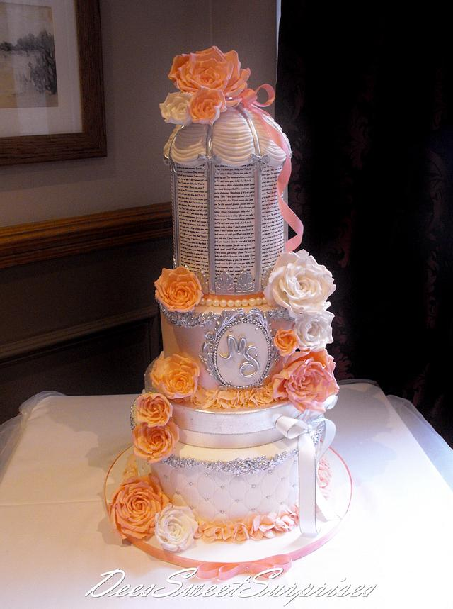 Coral, white and silver Birdcage wedding cake