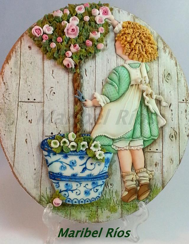 Niña podando rosal/pruning rose girl