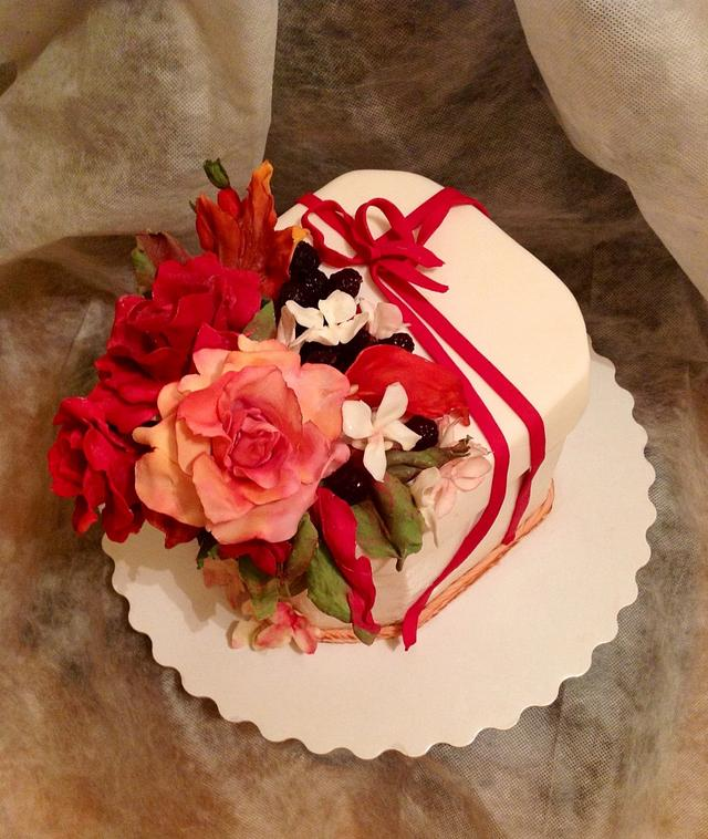 Cake with autumn leaves and flowers