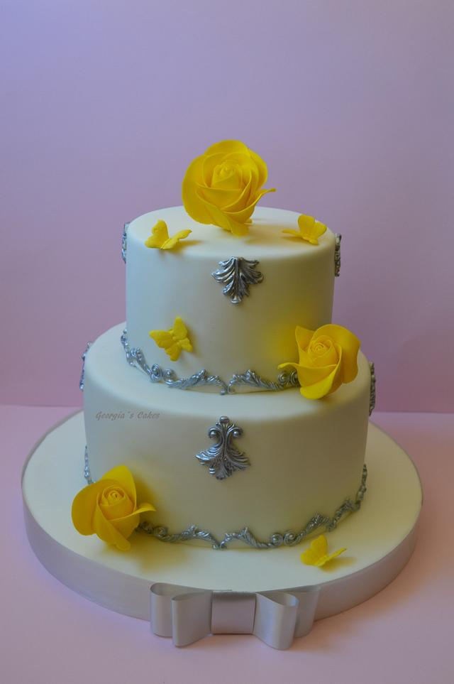 Birthday cake in silver and yellow roses