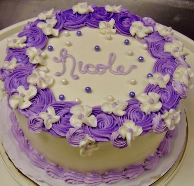 Purple rosette and white floral cake