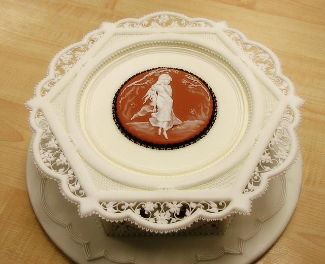 Royal icing panelled cake with pressure piping