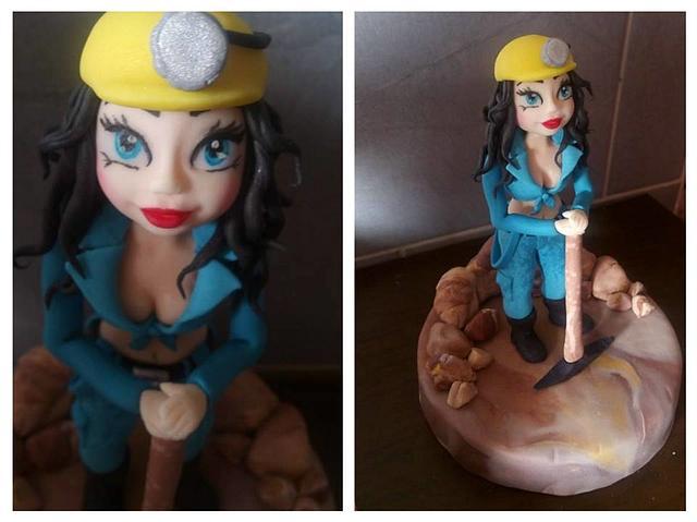 Female miner figurine