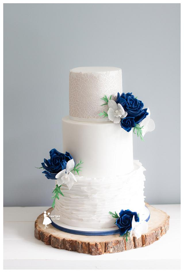 Navy blue roses with puren white orchids