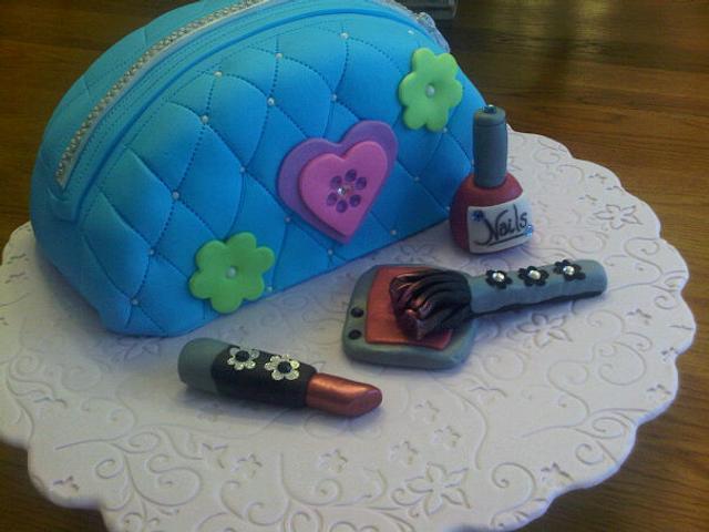 Makeup bag cake with edible makeup