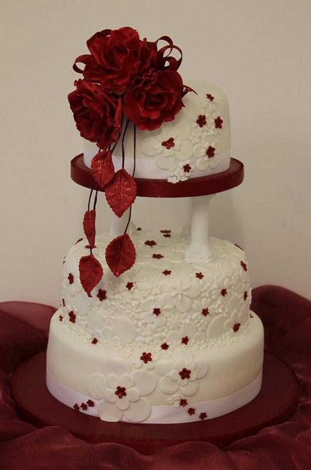 Embossed wedding cake with red rose topper