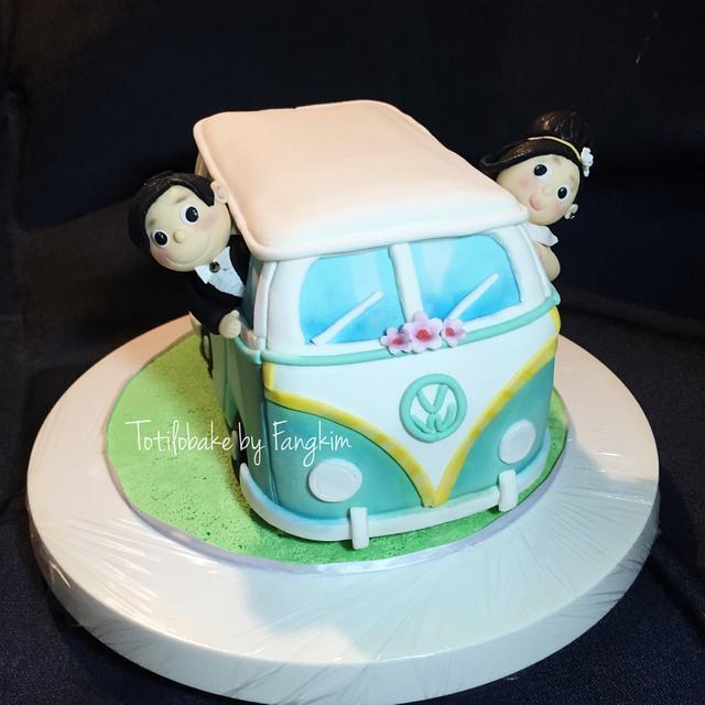 Volkswagen Van with groom and bride
