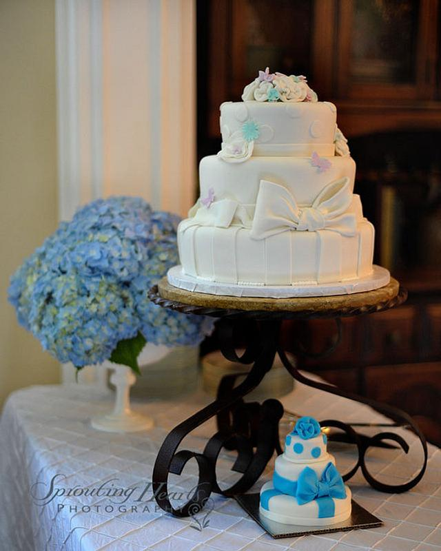 White and Pastel colored elegant baby shower cake with matching Cakeling for the Daddy to be.