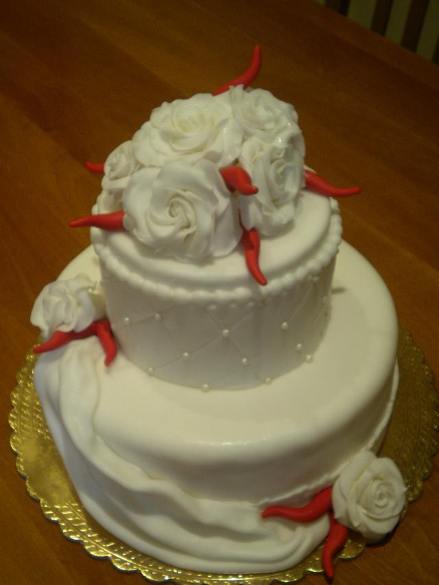 White roses and red horns