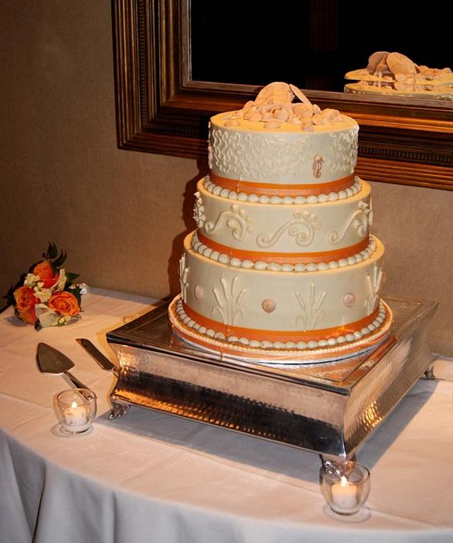 Beach wedding cake in sunset colors