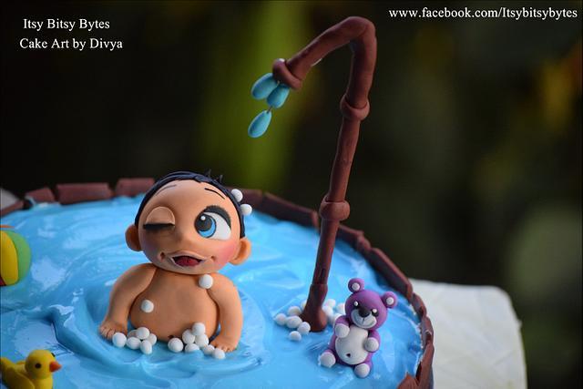 Naughty baby in a bathtub cake
