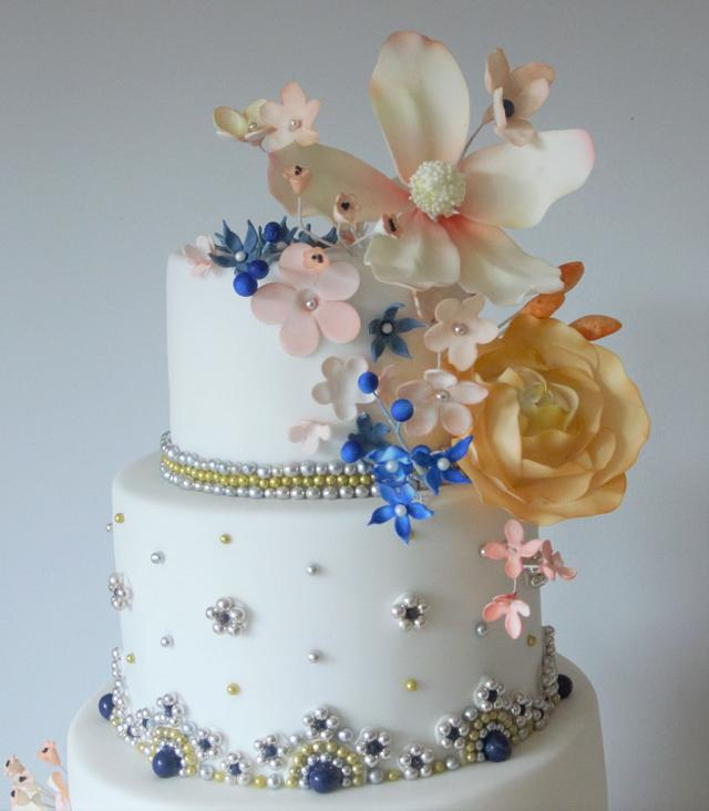 5 tier Asian wedding cake with beads and flowers