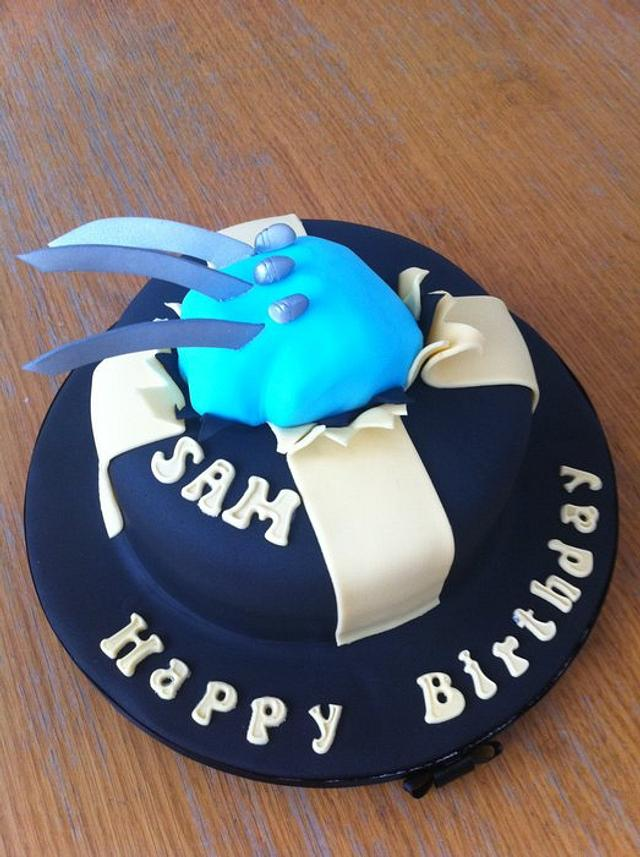 wolverine fist with claws out of cake